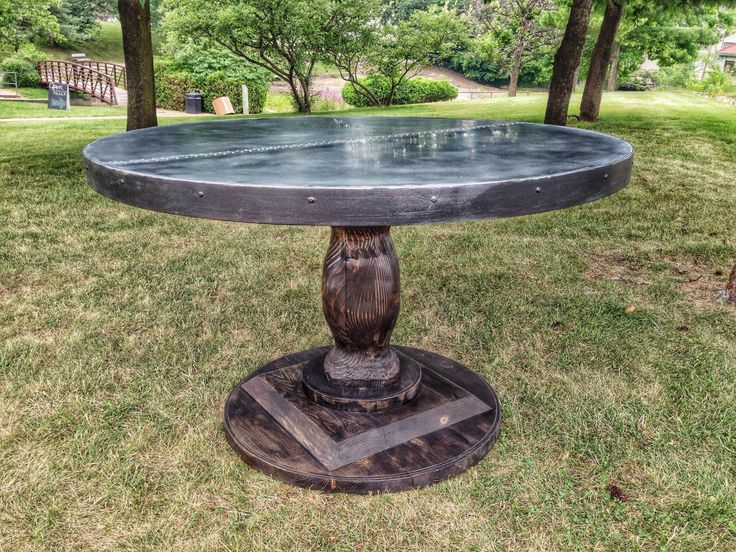 Rustic Round Zinc Table with Carved Wood Pedestal Base by Zincsmith on Etsy https://www.etsy.com/listing/217570645/rustic-round-zinc-table-with-carved-wood