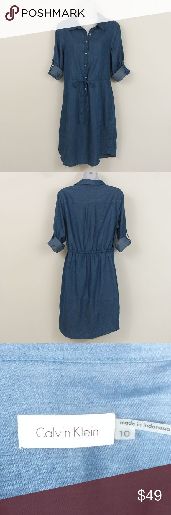 Calvin Klein Chambray Shirt Dress Roll-tab sleeves can be worn long or short.  Size information: Women's Size 10 (US). Dress about knee length.  Condition Notes: New Without Tags (deadstock returns)  We will consider all reasonable offers. Thanks for shopping with us! Calvin Klein Dresses Midi