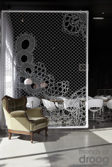 Interesting idea for a room divider. Weave patterns with wire or string into chain link fencing. Hmmm