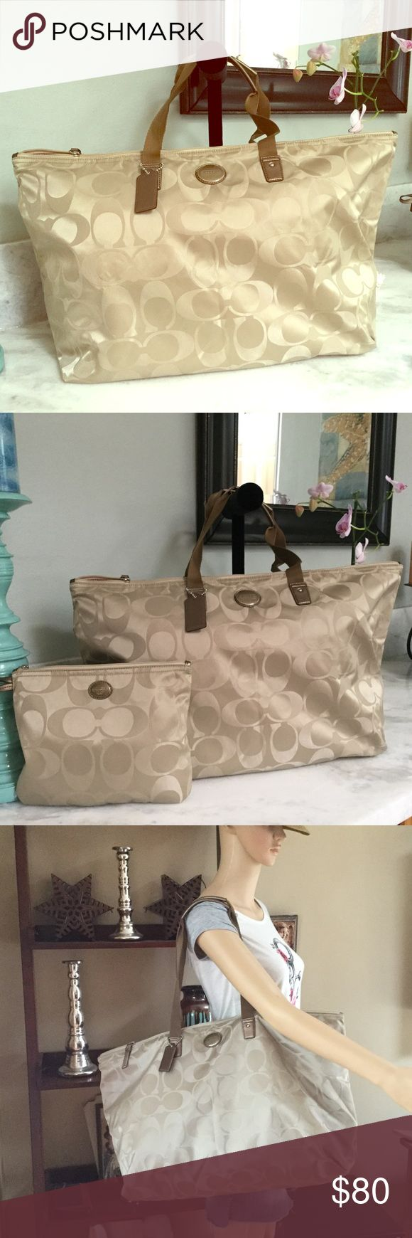 COACH TRAVEL BAG Beautiful coach bag it's very big with detachable small bag in perfect conditions no flaws it measures 22x14 small bag 11x8 cloths like material Coach Bags Travel Bags
