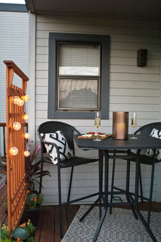 Turn even the smallest terrace into an outdoor oasis with  a chic patio bistro set. A trellis outfitted with string lights provides extra privacy and ambiance.