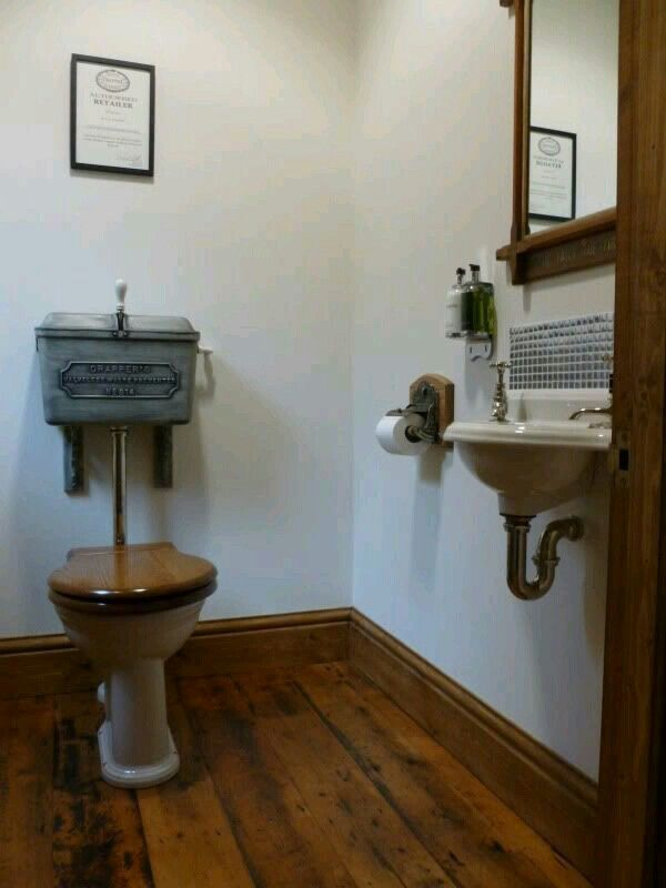Old fashioned toilet & vanity sink.