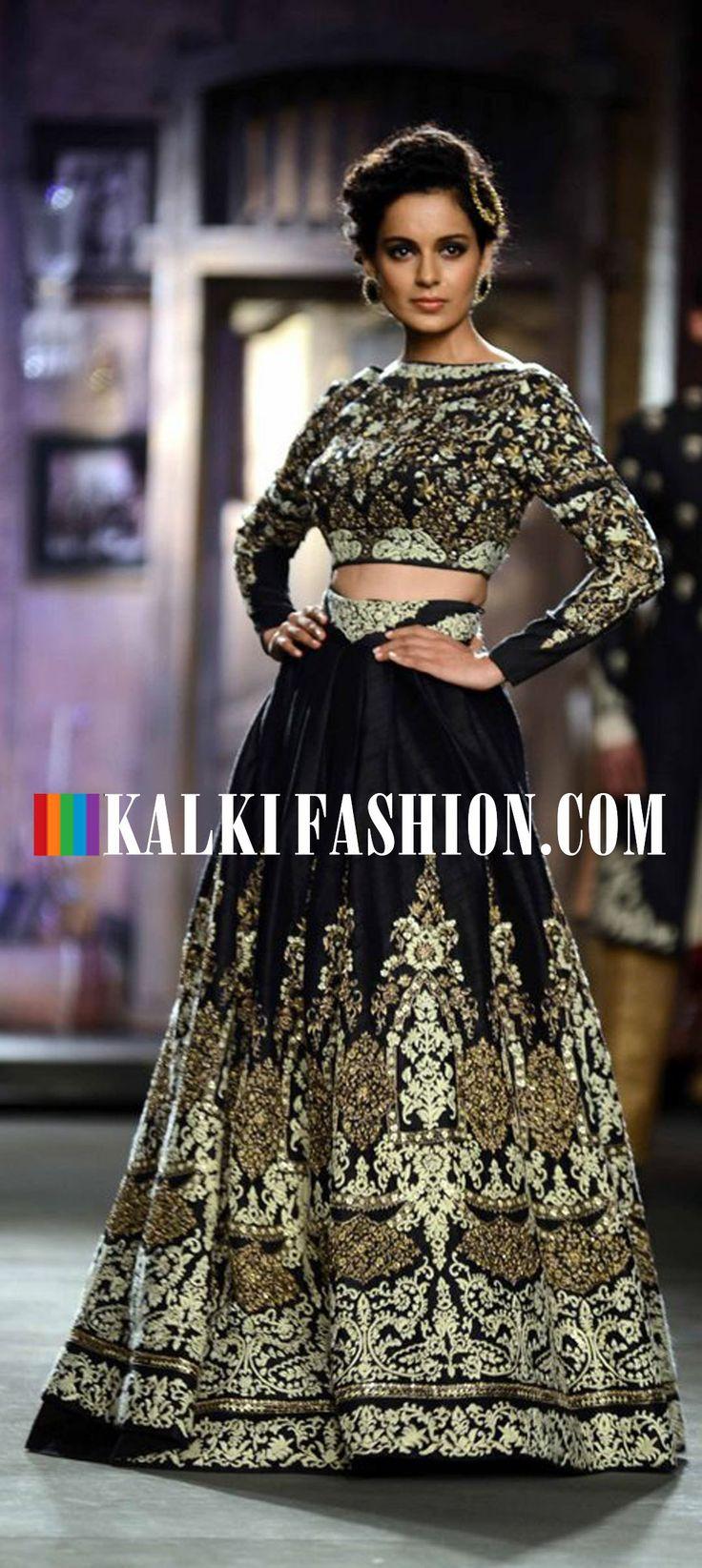 Kangana Ranaut walks the ramp in black embellished gown for Anju Modi at Indian Couture Week. http://www.kalkifashion.com/