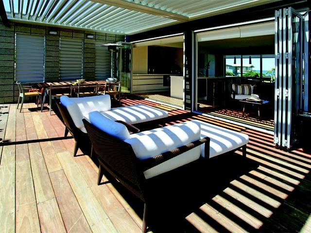 Bi-folding doors blur the boundary between indoor and outdoor living in this stunning beach house.