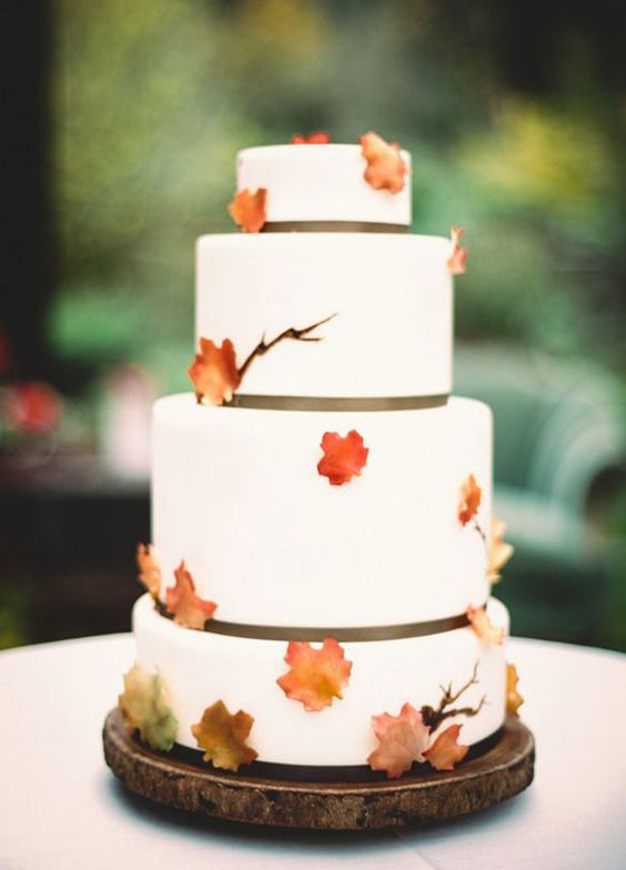 Rustic chic white fall wedding cake accented with orange leaves; Via Midori Bakery