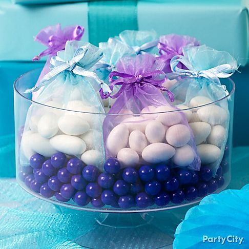 Jordan almonds in organza favor bags = pretty centerpiece. They come in 8 colors to match your party!