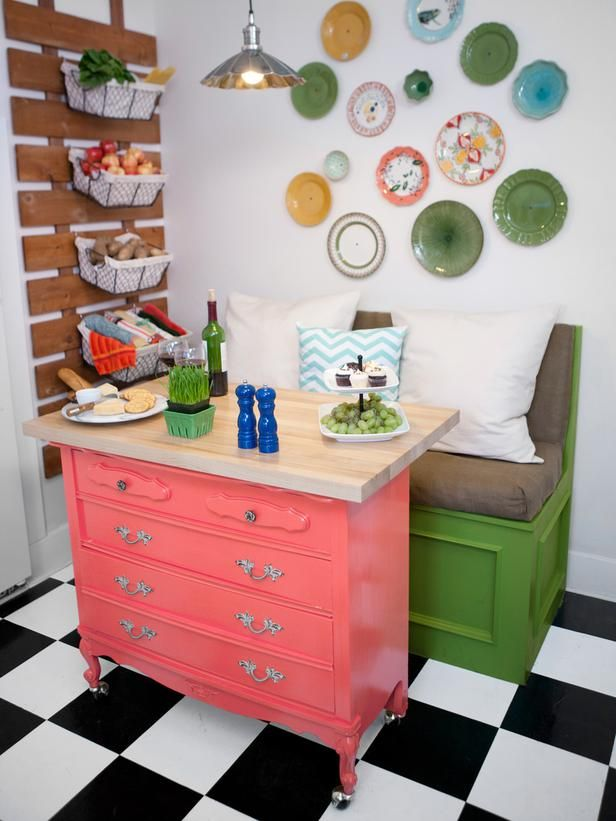 Great idea - use a dresser on casters as both a small island and a table for a banquette seat.  Lighting - Kitchen Design Tips From HGTV Stars on HGTV