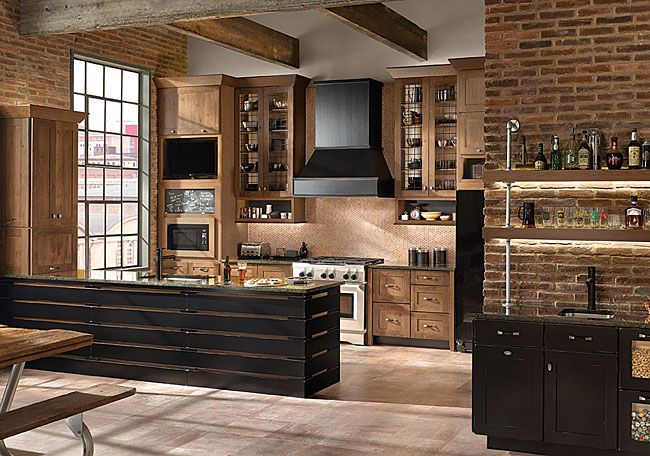 This kitchen features a TV/Microwave messaging centre for quick meals on the run and then a wall appliance garage that opens up to store small appliances.Also included are a bar area to keep the relaxing-with-a-drink crowd out of the way of the cooks in the kitchen.