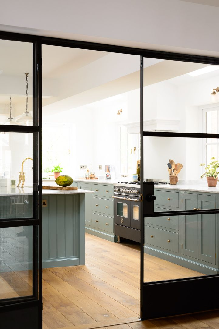Amazing crittall style sliding doors leading to the beautiful new Trinity Blue Kitchen by deVOL