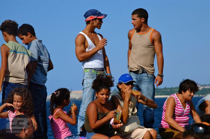 Enjoying the Sun on the Malecon photo | 23 Photos Of Havana