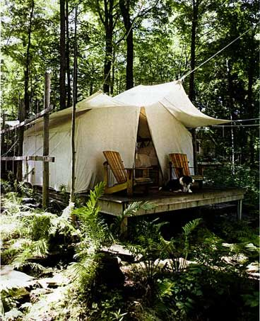A luxury tent in the woods you dont need anything but the for Permanent tent cabins