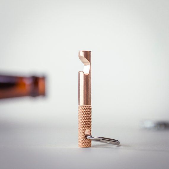 PLEASE NOTE: this item ships within 3-5 days of purchase. This custom designed bottle opener keychain is CNC machined from solid phosphor bronze. The craftsmanship, attention to detail, and material choice for this product allow the minimalist design to have maximum impact. The keychain is 5/16 (8mm) in diameter and is 2.25 (32mm) long. The geometry of the opener has been optimized to allow the opener to perfectly grab the bottle cap and remove it on the first try every time its used. Th...