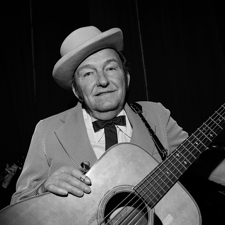 """Lester Flatt, Ryman Auditorium, Nashville, Tenn., 1972. """"Lester Flatt and banjoist Earl Scruggs were the successful Flatt and Scruggs. Flatt's contributions included strong baritone vocals and a signature guitar run, widely imitated even today."""" Photo by Henry Horenstein."""