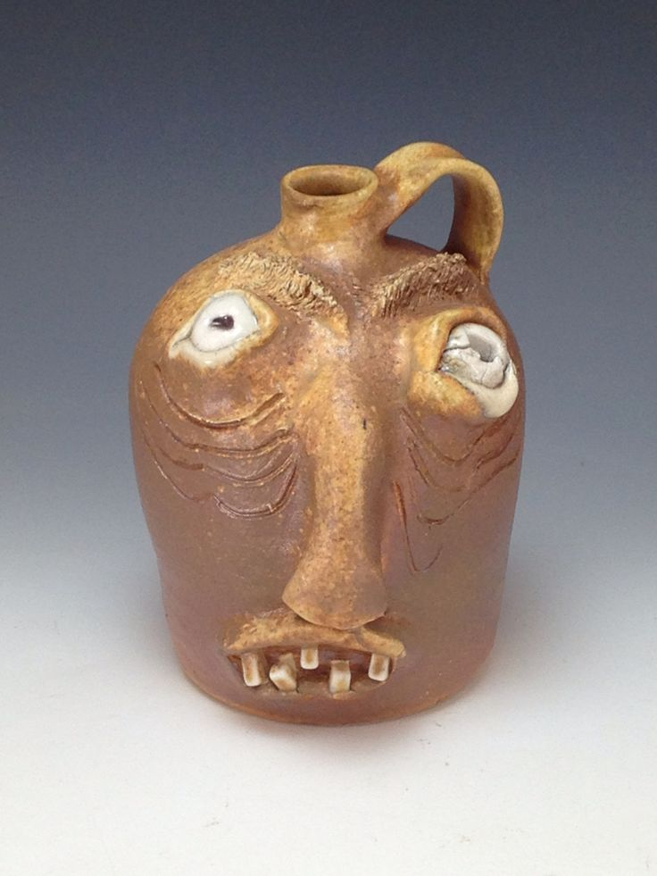Wood. Fired Face jug made from local clay #lowellwebb #facejugs #growler #pottery