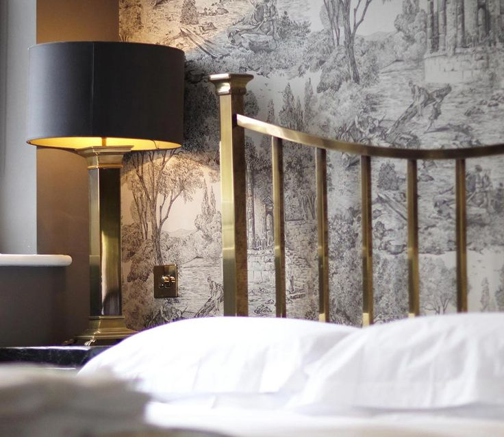 Detail of And So To Bed's Sage brass bed in The Bull Hotel - 207 Rooftops - Bridport, Dorset, England.