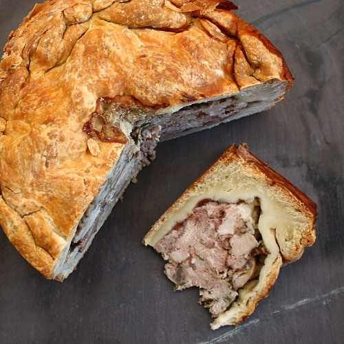 A country style raised game pie - rabbit, pigeon, venison