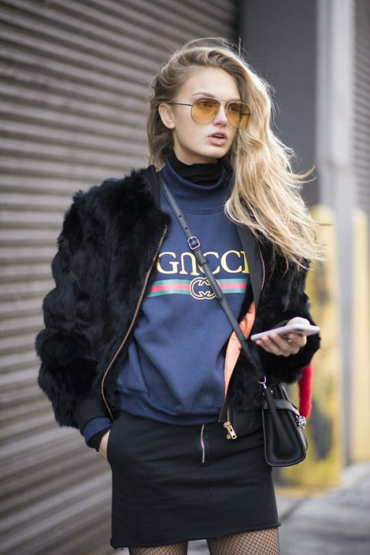 Romee Strijd paired tinted shades with a Gucci logo shirt during New York Fashion Week