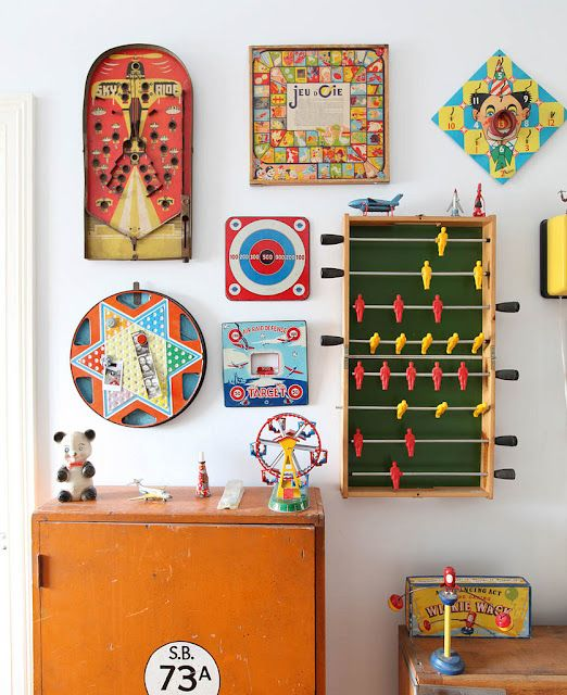 vintage games in the kids room - Or a game room...this would be cool at my parents house but we still play old games so having them on the wall might not work too well but I love the idea!