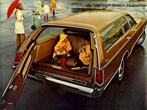 """Station wagon's """"way back"""" seat.  Some faced sideways, facing each other."""