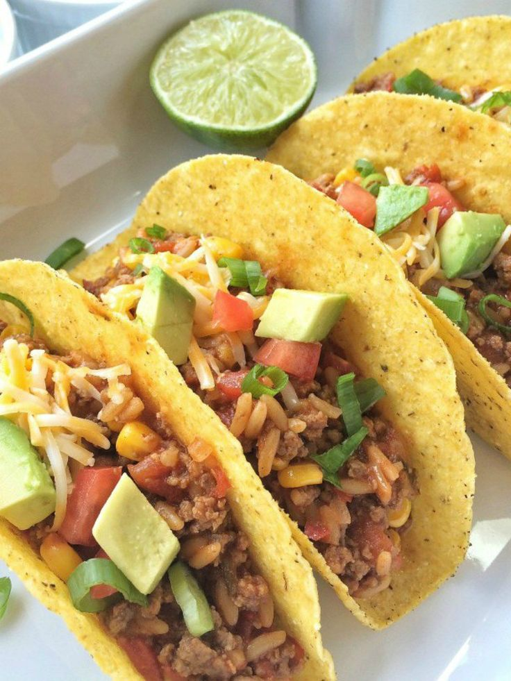 These ground beef texas tacos are taken up a notch with rice & beans, corn, diced tomato, and some fresh lime juice! Serve with your favorite taco toppings and you have a hearty, filling, and delicious twist on the traditional taco.