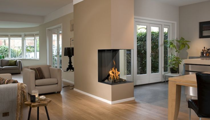 View Bell Vertical 3  •Classy built-in fireplace •hidden door framework •wood trunks, white or grey pebble stones •flat rear wall •ceramic burner •very realistic play of flames •sizes: small, medium, large, vertical ,room divider medium, room divider large.
