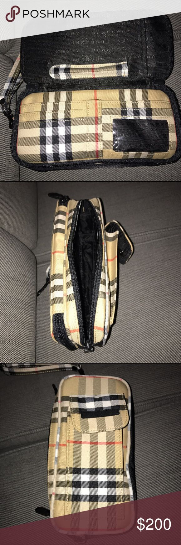 """Burberry Golf pouch/wallet Can be for both men and women.  Lots of compartments plus an exterior pouch that could be used for a cell phone. There is storage for golf tees.  The wristlet also features 2 fully zippered compartments. One has plenty of room.  The zippered compartment has 3 smaller slip pockets to hold your credit cards. On the under side of the outside cover is another pocket and a pen holder.  Condition: New Manufacturer: Burberry Material: Coated Canvas Measurements: 8 1/2""""…"""