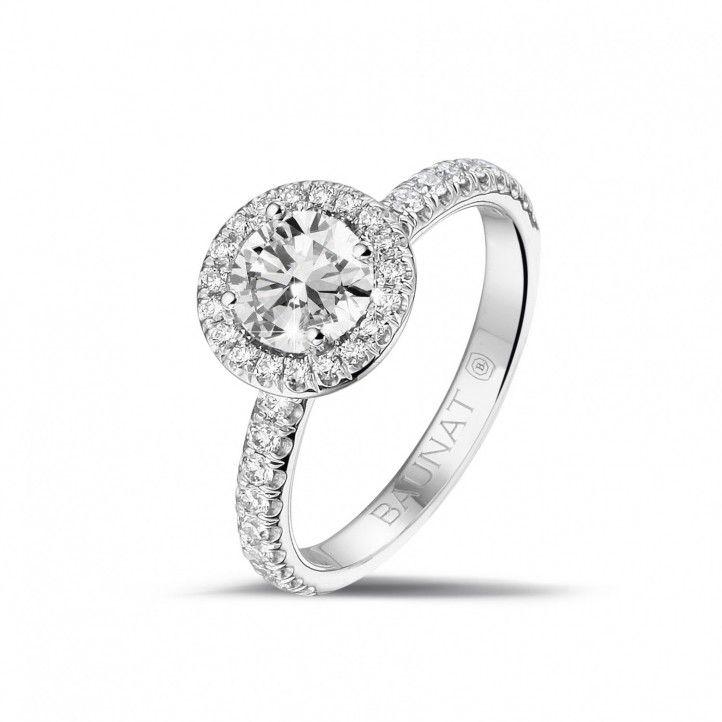 0.70 caraat Halo solitaire ring in platina met ronde diamanten