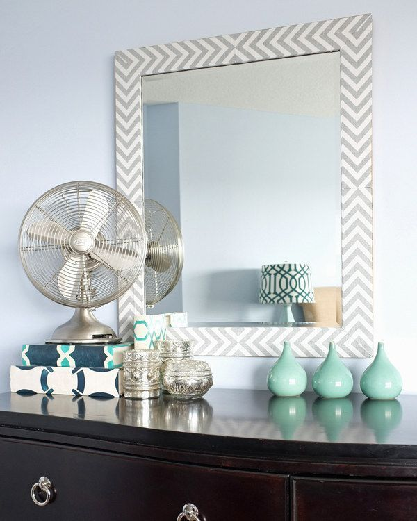 Cover a boring mirror with a fabric that you love.