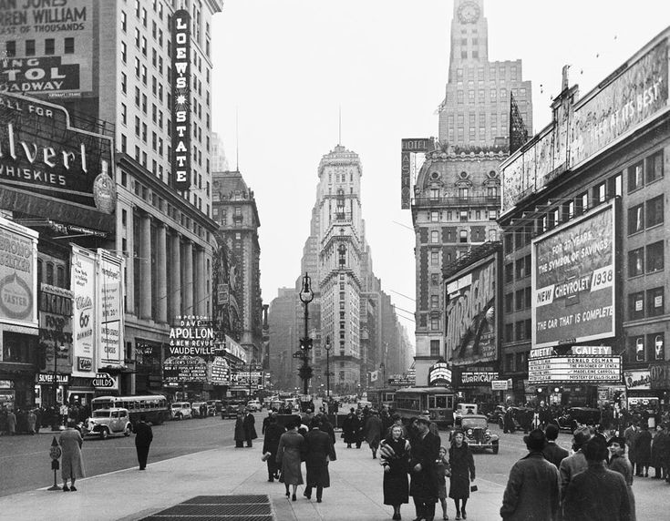 Times Square theaters by day, in New York City. The Times Building, Loew's Theatre, Hotel Astor, Gaiety Theatre and other landmarks are featured in this January, 1938 photo.