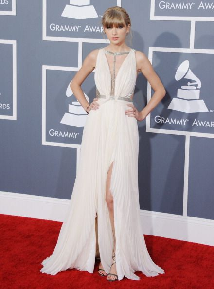 In a J. Mendel gown at 55th Annual Grammy Awards in Los Angeles. See Taylor Swift's full fashion evolution, from sequins in 2007 to her many crop tops today.
