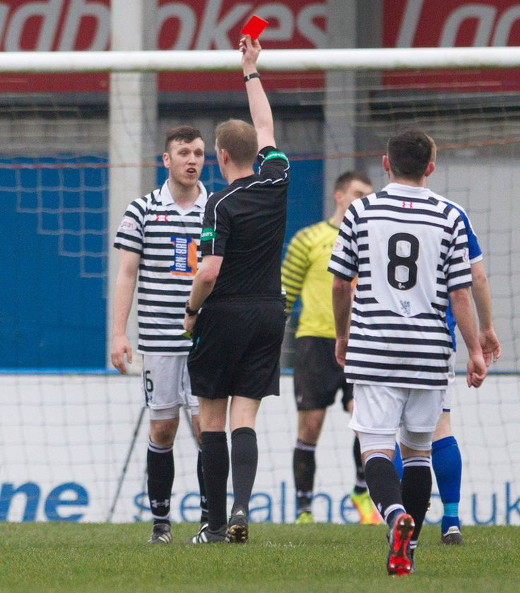 Referee Gavin Ross sends Queen's Park's Adam Cummins off during the Ladbrokes League One game between Stranraer and Queen's Park.