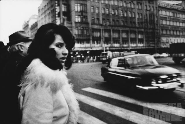 Prague, Na Můstku; 1976, She was waiting for the green light at a pedestrian crossing. I aimed my leica at her hoping she would turn round facing me. - Jaroslav Kučera
