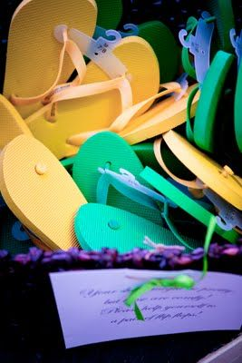 Basket Of Cheap Flip Flops For Guests To Put On While Dancing During The Reception