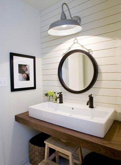 extra long trough sink with two faucets and a gooseneck light