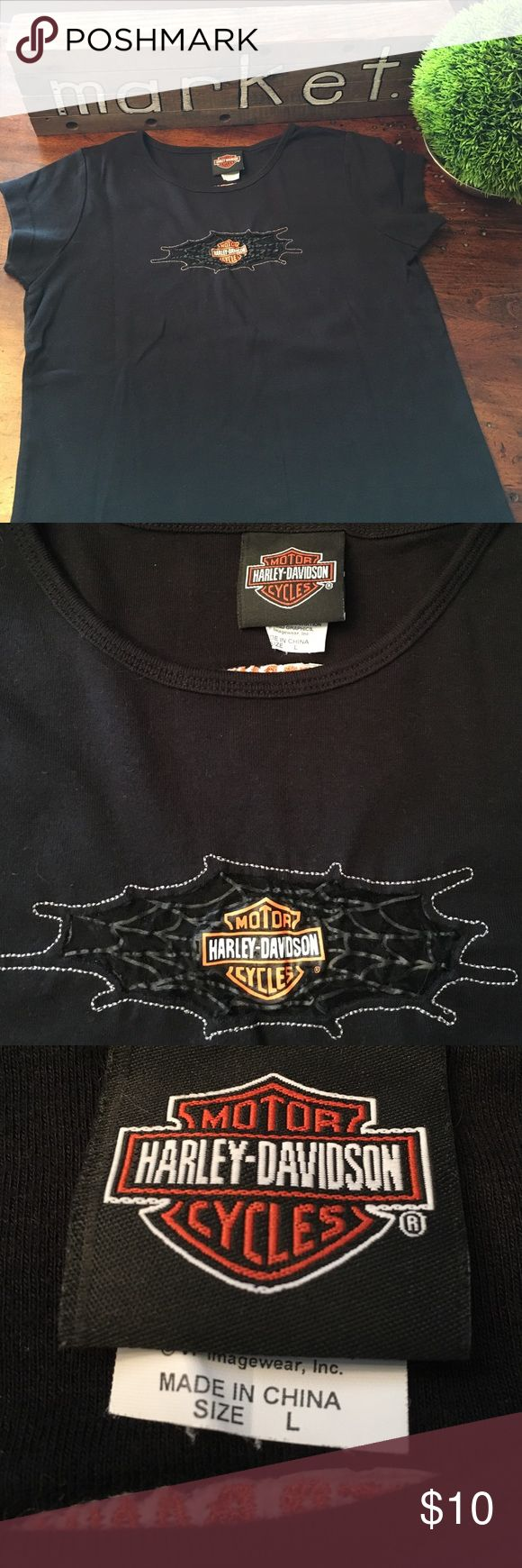 Harley Davidson tee Authentic Harley-Davidson black t-shirt. Size L but fits more like a ladies sm/md. Like new. Features a sheer web front design on chest with decal. Crew neck. Harley-Davidson Tops Tees - Short Sleeve