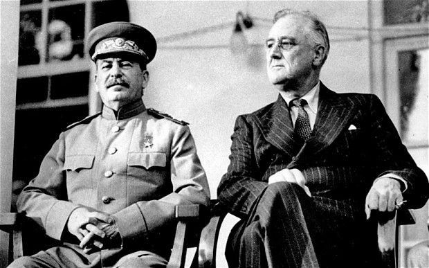 Declassified U.S. documents appear to confirm that  U.S. President Franklin D. Roosevelt, right, hushed up the Katyn massacre in order to maintain close relations with Joseph Stalin, left.