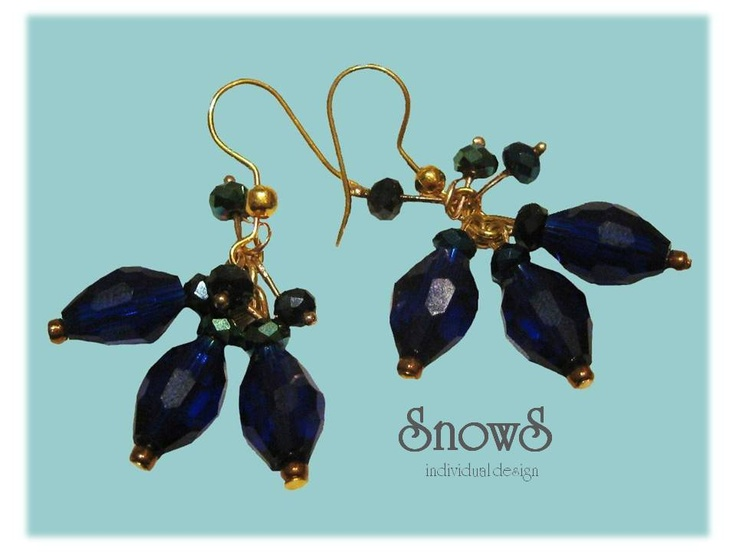 Blue tear-drop earrings with sparkling gemstones.
