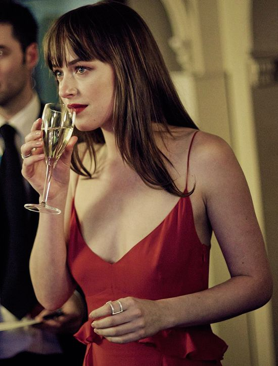 Dakota Johnson as Anastasia in a red slip dress and matching lipstick. | Fifty Shades of Grey