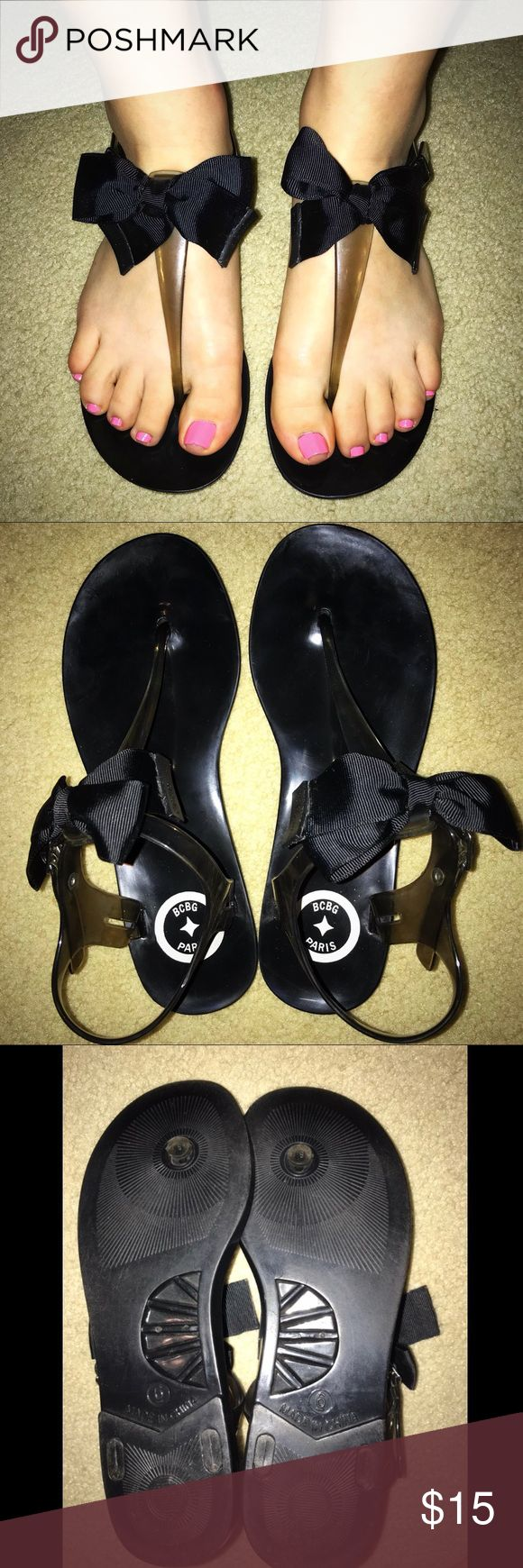 BCBG black ribbon / bow jelly sandals These sandals are in AWESOME condition and have barely been worn! They are comfy, cute, designer, and go with everything :) BCBG Shoes Sandals