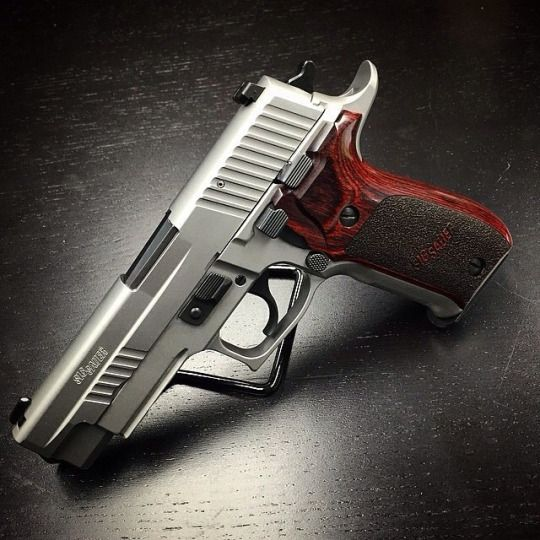 SIG SAUER P226 Elite Stainless with Rosewood Grips I have this baby and love it for my every day carry!