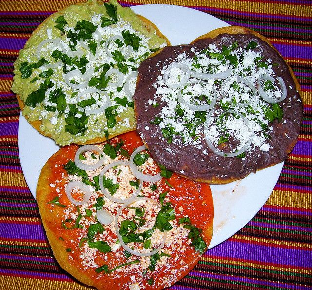 Healthy Tostadas Guatemaltecas, one guacamole, one black bean, one read sauce.