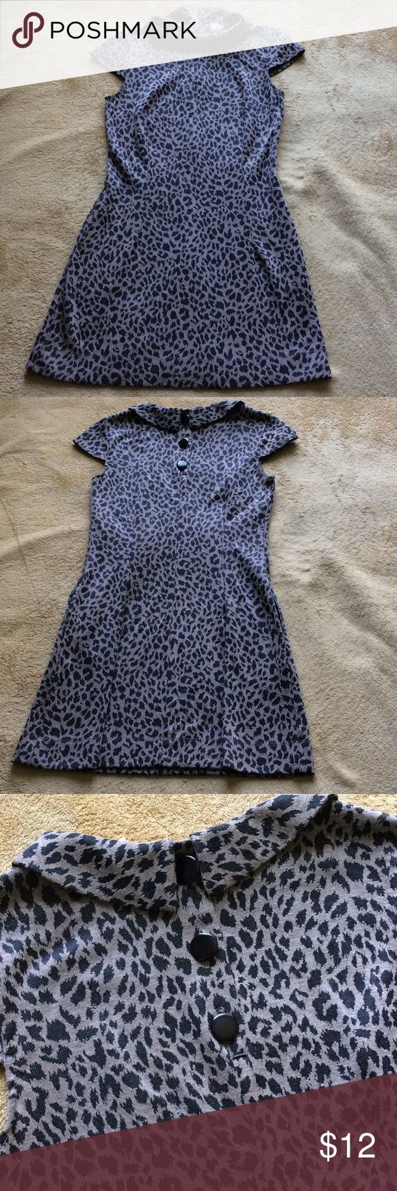 Animal print Mini dress size S Animal print Mini dress size S. It's a gently used mini dress. It's a vintage style kind of dress with 3 bottom in the back and two open side pockets. This dress has no stain or cut. Length 32 inches. AUW Dresses Mini