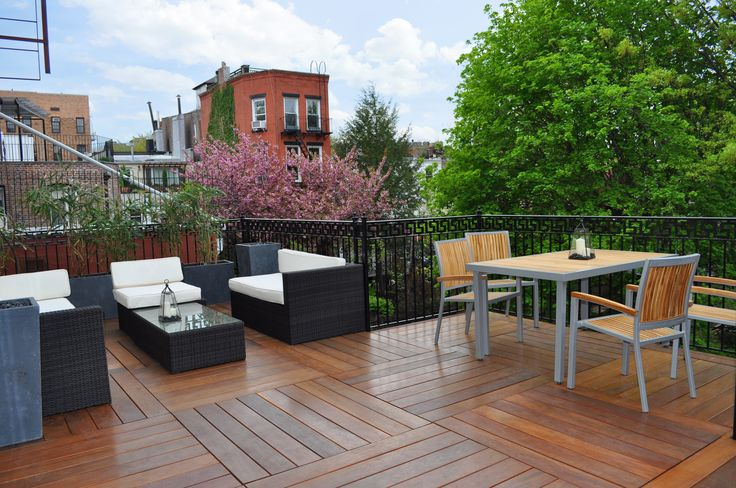 When you step onto a deck made of Cumaru, you'll be presented with a rich display of golden tan to reddish brown colors and dark grain accents. #cumaru #custom #deck #decking #city #urban #natural