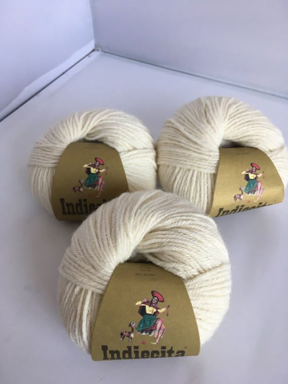 Indiecita DK Materials: 100% Luxurious Baby Alpaca Yarn Color: Ivory Very soft and easy to work with.  Perfect for knitting and crochet .  Price is per ball.  Quantity: 10 balls.  Made in Peru. Hand-wash and lay flat to dry. Please note that monitors brightness, contrast etc. may cause a