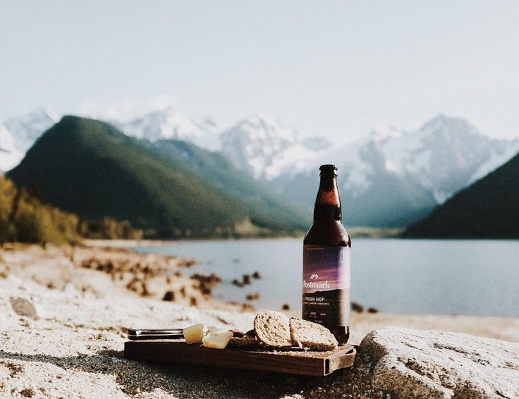 Mountain charcuterie. #getoutdoors #upknorth Lakeside with our favourite local meats cheeses and beers from @postmarkbrewing. Shop our camp cutting board online. Jones Lake BC. Photo by @hennygraphy by upknorth