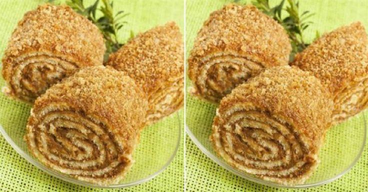 Ingrediente: Pentru aluat: -2 pahare de făină (300 g); -4 linguri de smântână grasă; -50-100 g unt sau margarină/unt; -0,5 pahar de zahăr (100 g); -1 ou; -1/4 linguriță sare; -1/4 linguriță bicarbonat de sodiu. Pentru umplutură: -1 pahar de nuci; -0,5 pahar de zahăr (100 g); -2 linguri de miere; -1/8 linguriță de scorțișoară. Mod de preparare: 1.Amestecați toate ingredientele pentru aluat și creați aluatul care va fi ușor dulce. 2.Întindeți aluatul într-o turtă cu o margin...