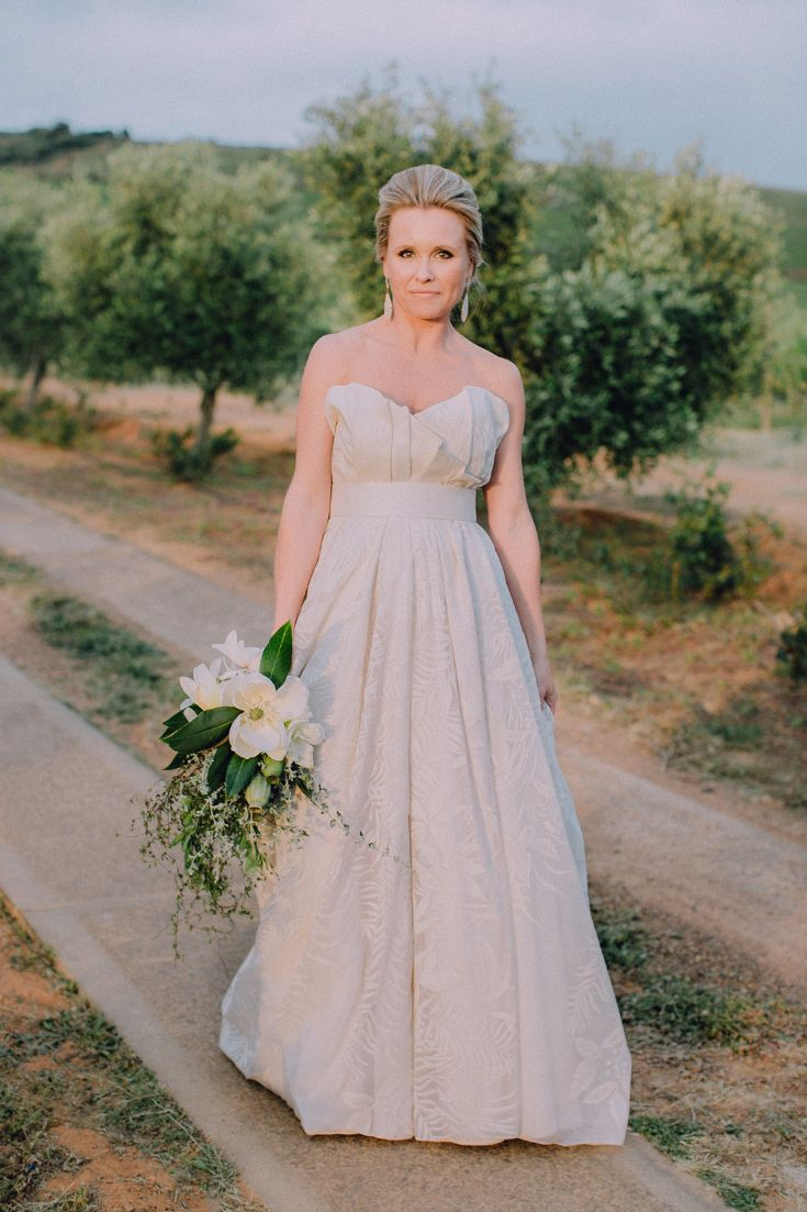 Ideas for strapless wedding gowns with a unique, dramatic design. Dress by Kluk CGDT