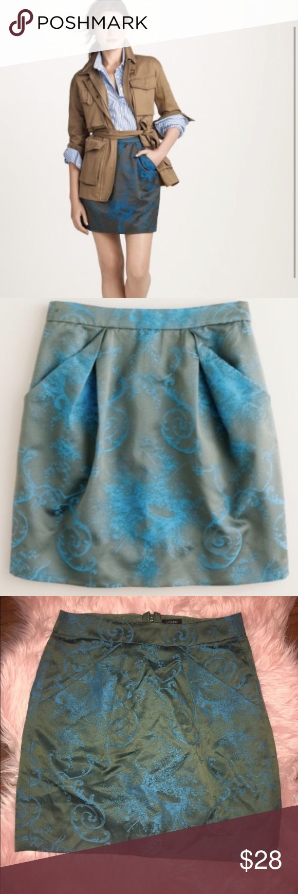 J Crew toile jacquard origami miniskirt Sz 2 sale! This J Crew Mini is perfect for summer to fall! A beautiful blue and green jacquard pattern and mid to lightweight fabric. Size 2. This was worn a few times and has a few wrinkles from storage but can be pressed or steamed out. Otherwise in perfect condition! Lowering price to make room in my closet! J. Crew Skirts Mini