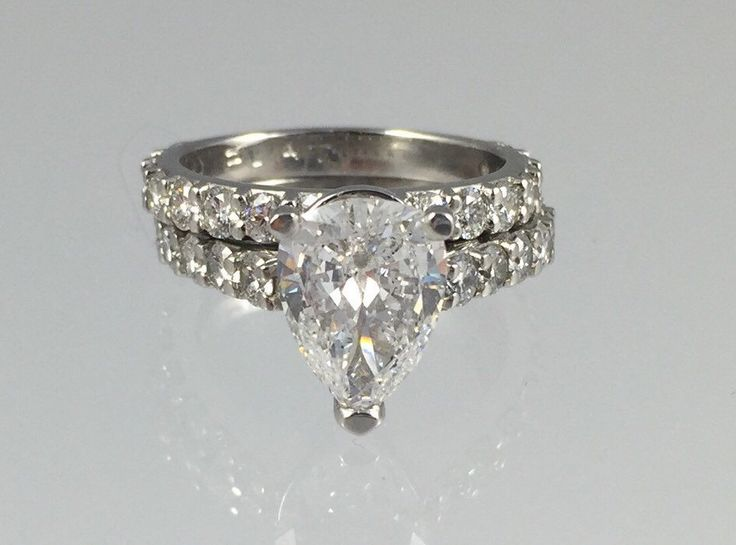 Platinum 2.20Ct Teardrop Cut Diamond Engagement Ring with Diamond Wedding  Band - Vintage 1950s Two Carat Diamond, 4.11CTW Size 6.25+ by MonteCristosNC on Etsy https://www.etsy.com/listing/241139865/platinum-220ct-teardrop-cut-diamond
