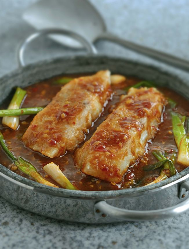This spicy, Chinese fish dish from Ken Hom's Complete Chinese Cookbook makes for a delicious dinner. This Sichuan inspired dish can use any white fish, such as cod, sea bass, halibut or haddock. Serve with plain rice and stir-fried vegetables for a great alternative to a Chinese takeaway.